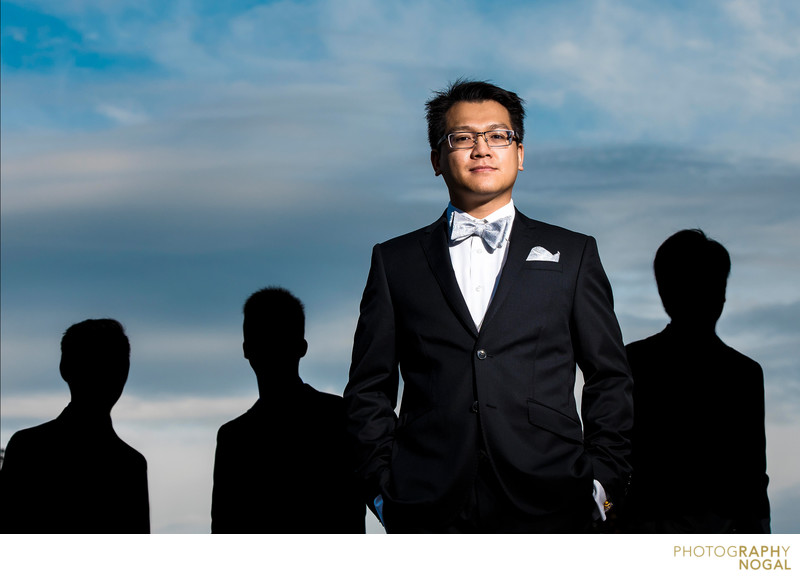 Groom with Silhouetted Groomsmen