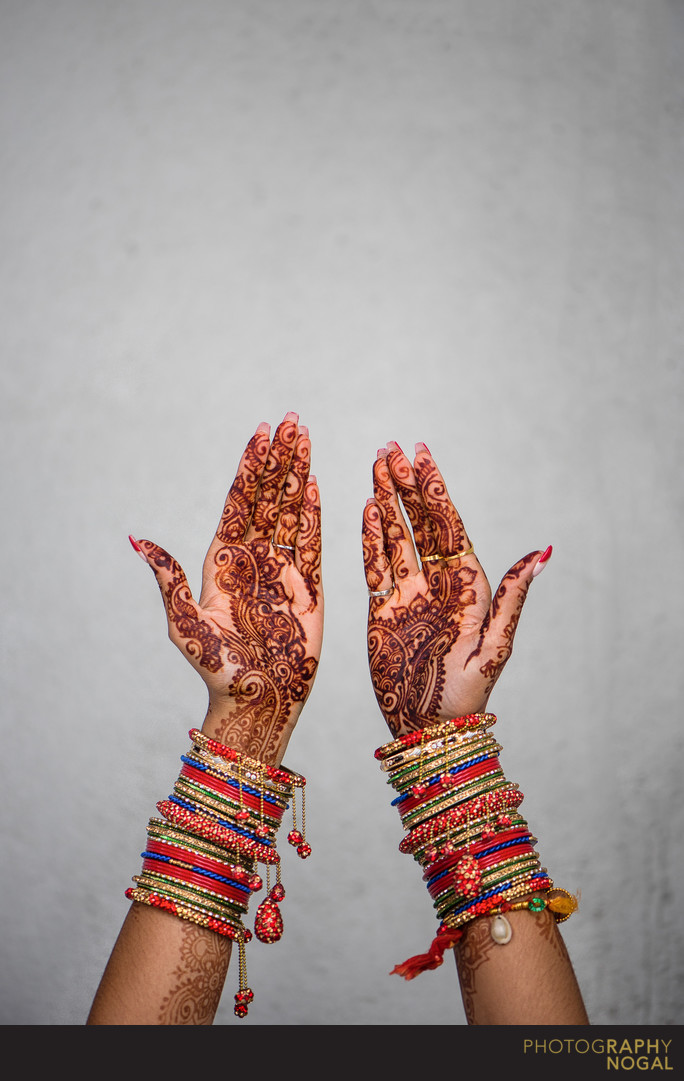 Bride's Hands with Mehndi Tattoo