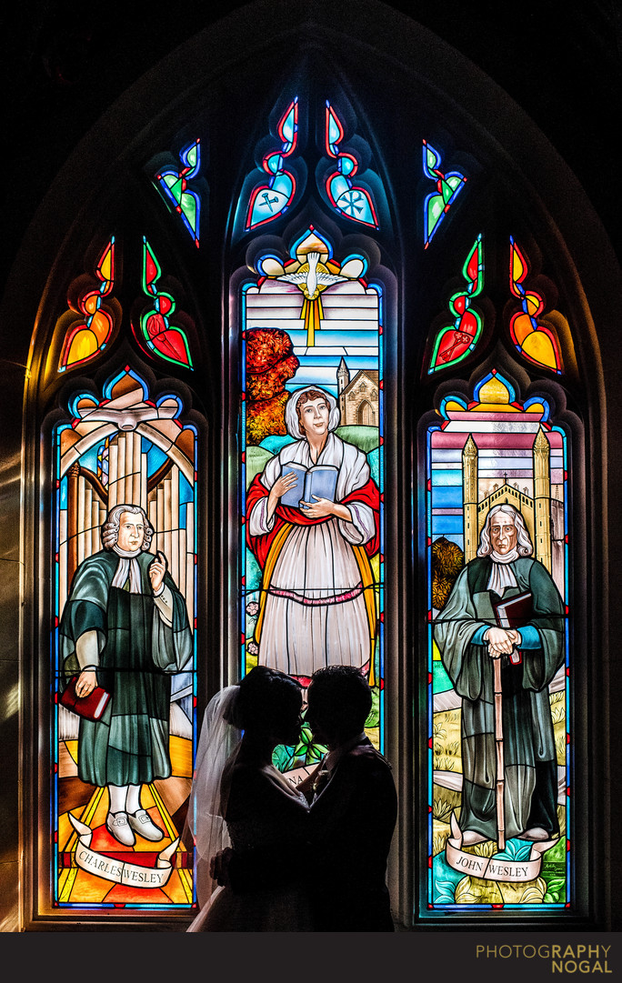 Couple Next To Stained Glass Window