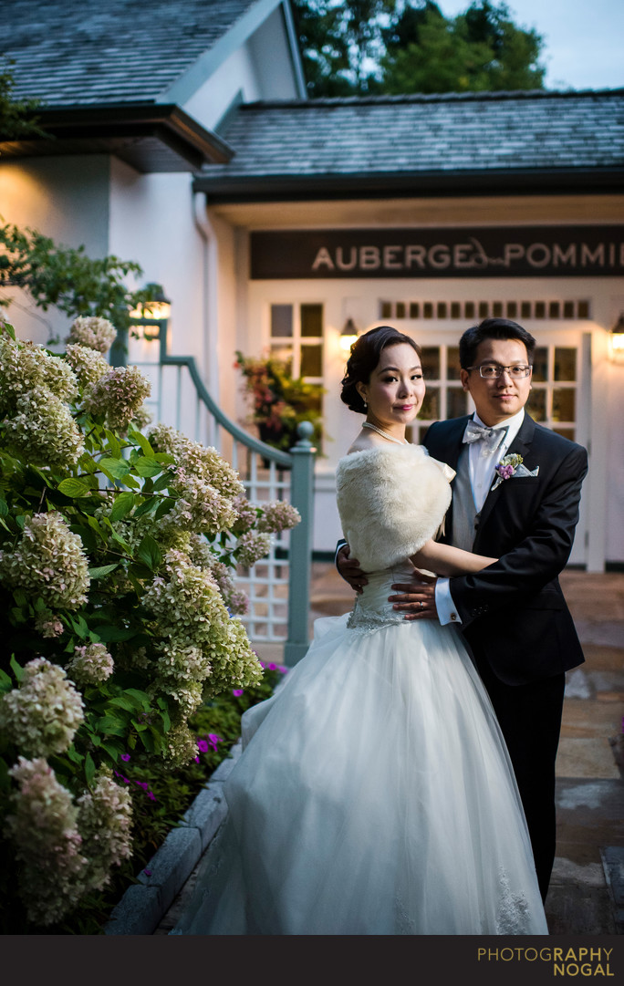 Bride and Groom Outside of Auberge du Pommier