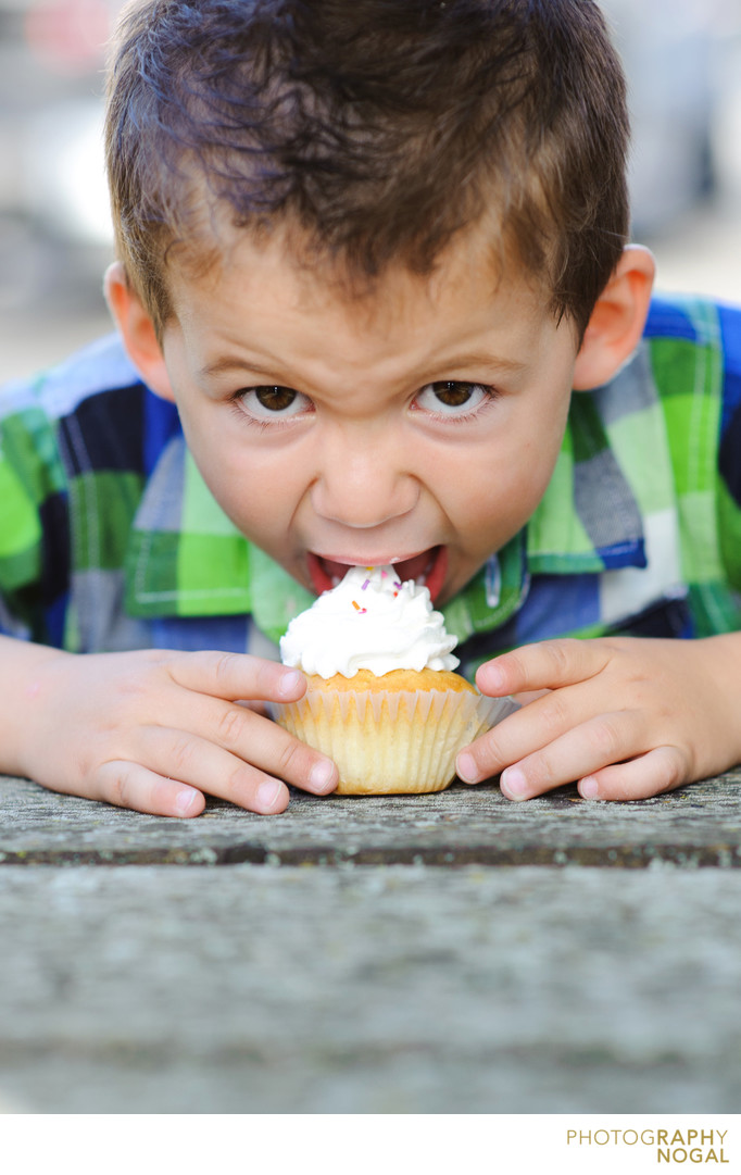 boy eating cupcake on his birthday