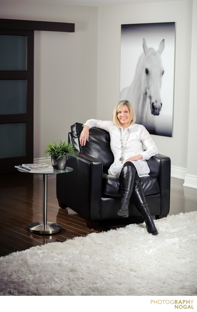 Toronto Real Estate Agent sitting on leather chair
