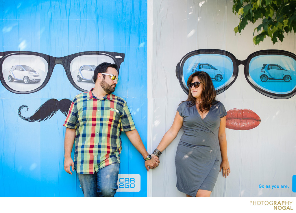 Couple Holding Hands Beside a Sunglasses Ad