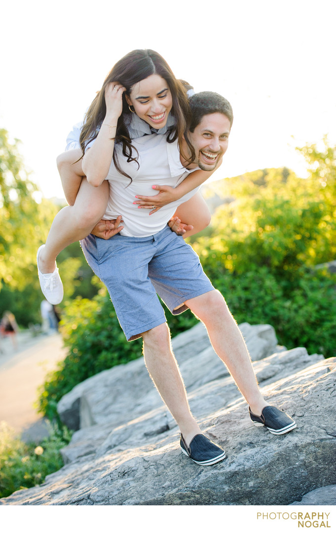 Port Credit session, man carries fiance over rocks