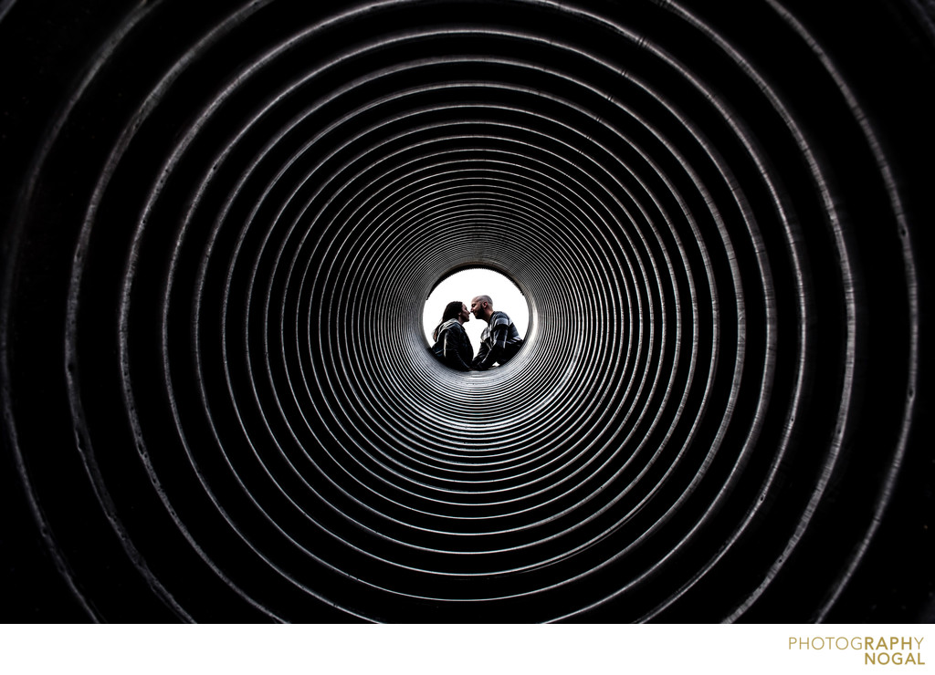 Couple kissing in the centre of a tunnel