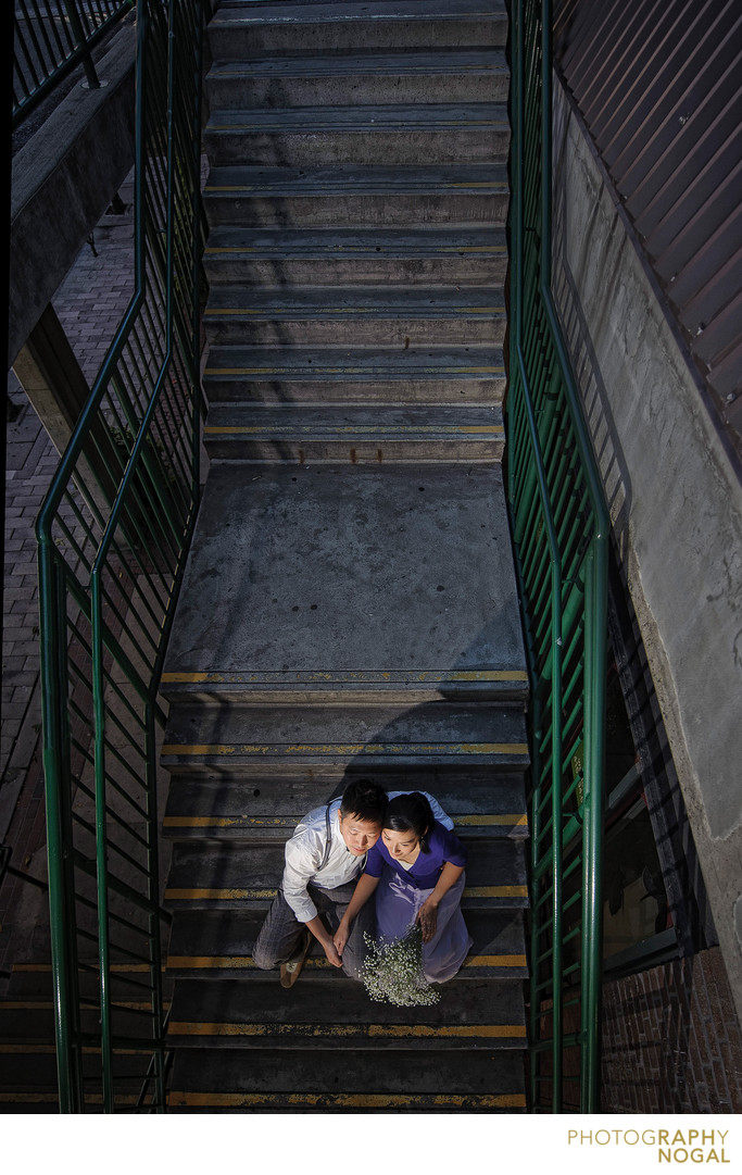 Young Toronto couple sits on the market staircase