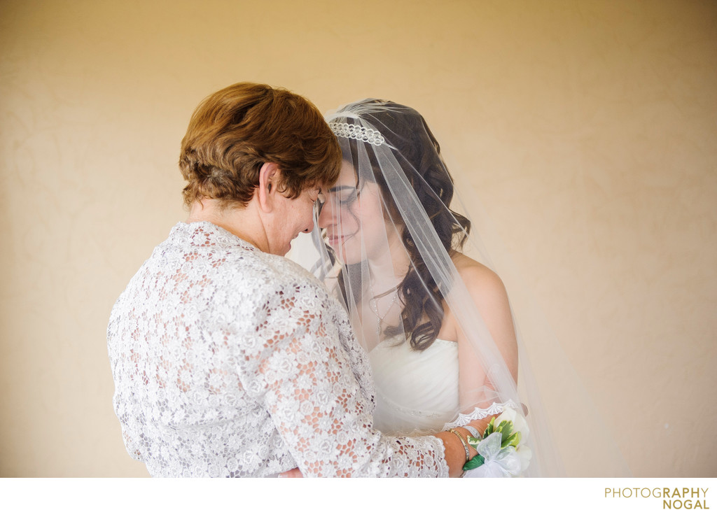 Bride and Mom Touching Foreheads in Silent Moment