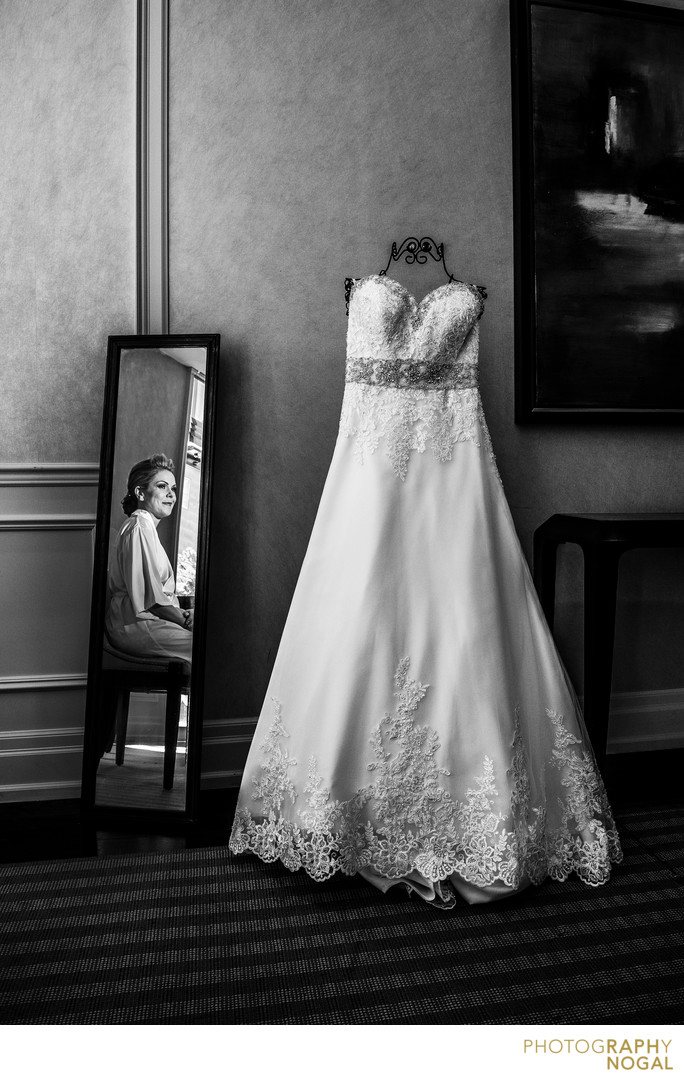 Bride in the Mirror Looking at Wedding Dress