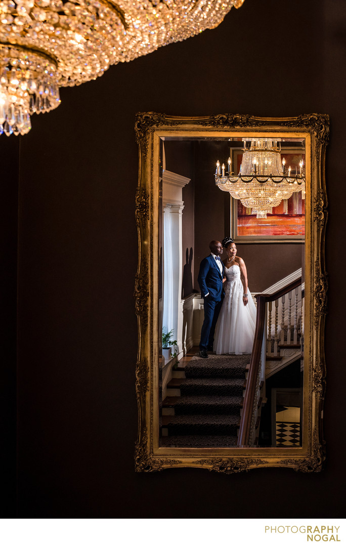 Bride and Groom in Mirror at Graydon Hall Manor