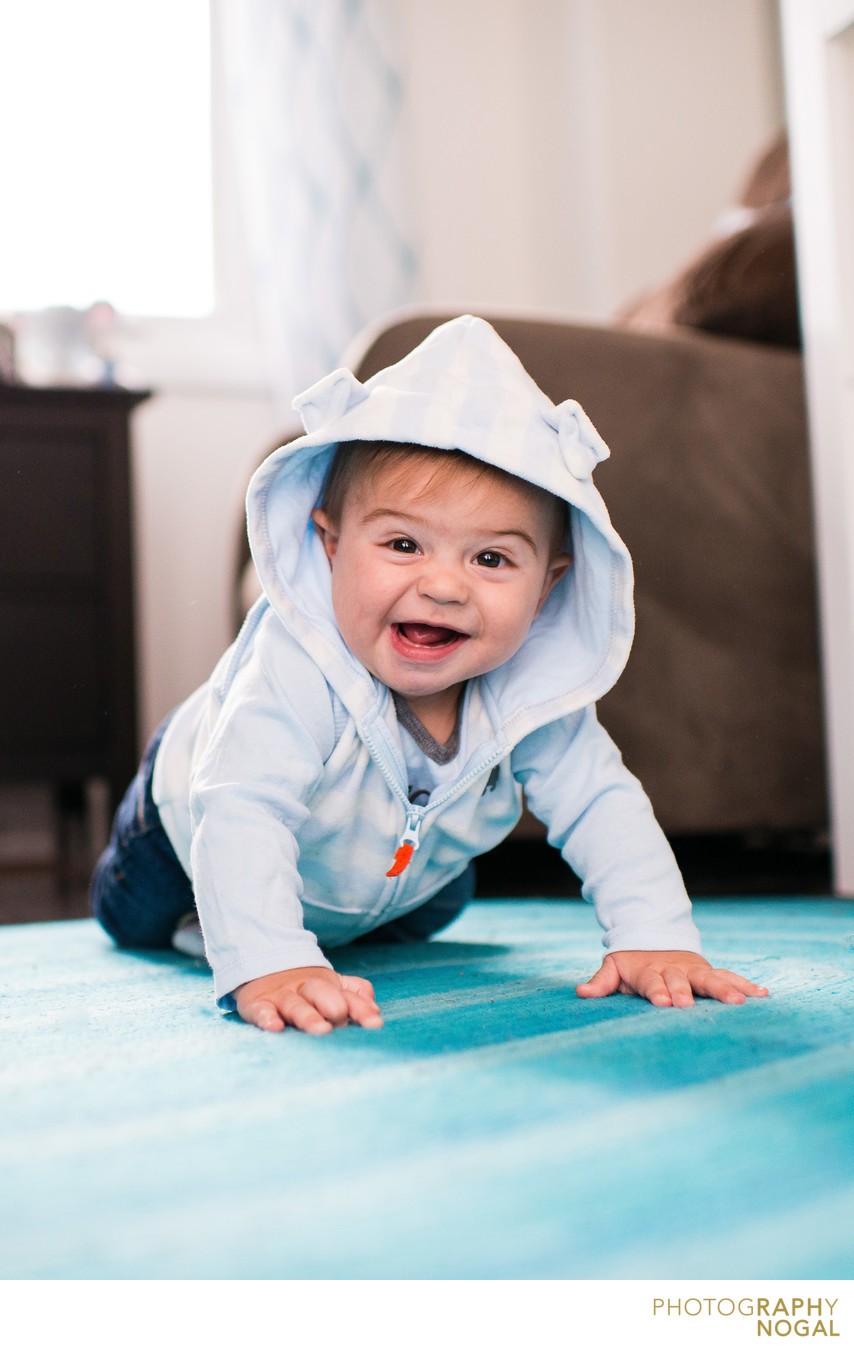 baby boy crawling on floor and smiling