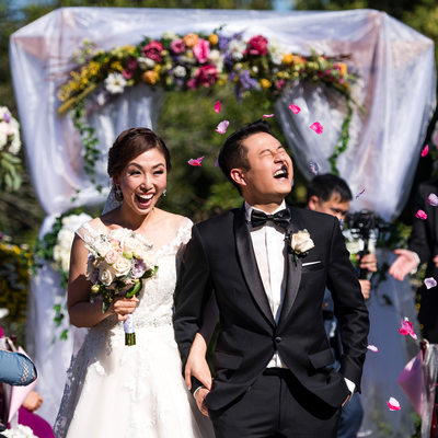 Groom Getting His In The Face With Flower Petals