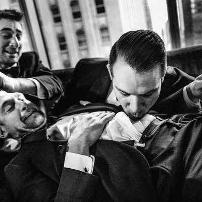 Groom and groomsmen doing a belly shot