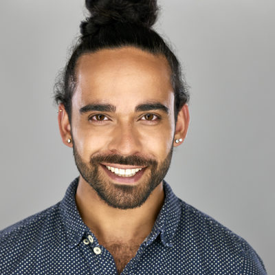 actor male dark skin headshot friendly look