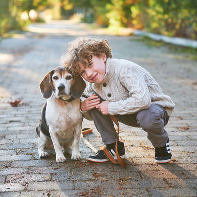 boy with beagle dog on a path in sam smith park