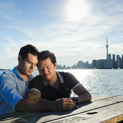 Couple at a picnic table, downtown Toronto background