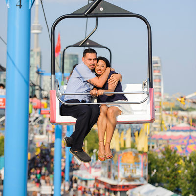 Engaged couple riding sky tram at CNE in Toronto