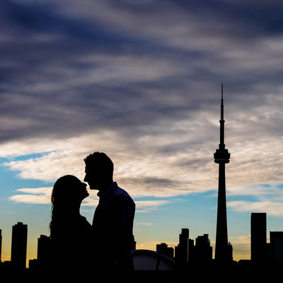 Engagement photos in Toronto featuring skyline