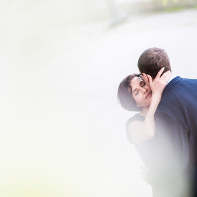 A woman embraces fiance on edge of Lake Ontario