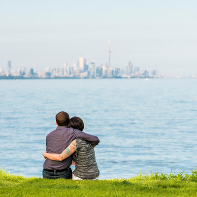 Toronto couple gazing upon downtown and CN tower