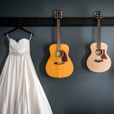 Wedding Dress Hanging With Guitars