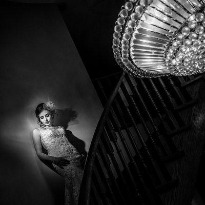 Bride on Stairs with Chandelier
