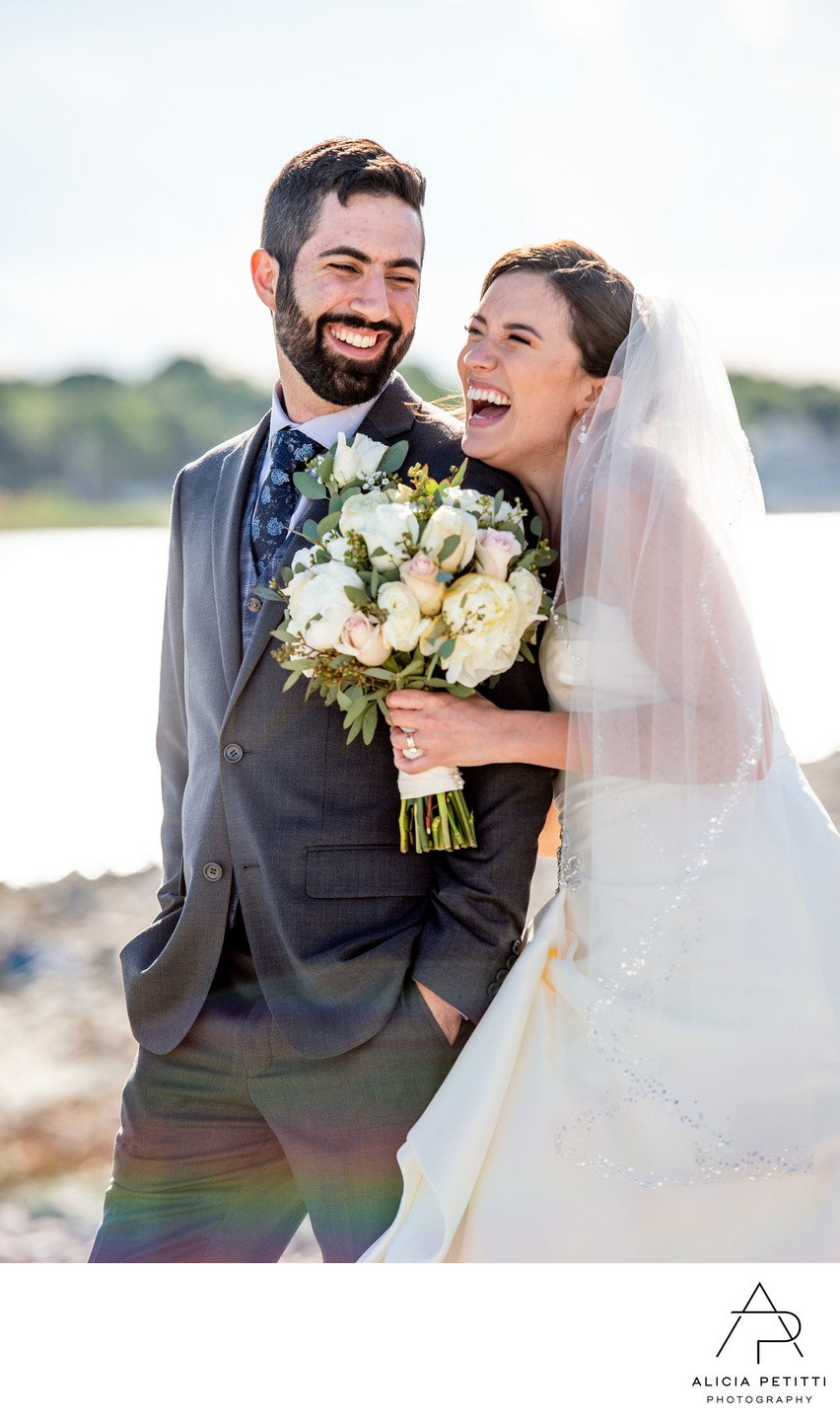 Scituate bride and groom laughing at each other.