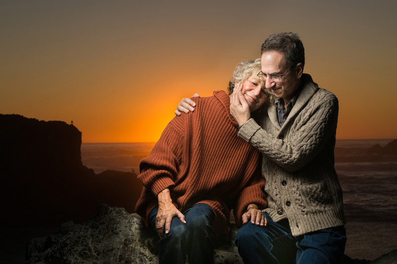 older couple posing together sunset