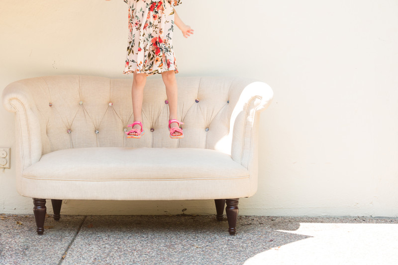 young-girl-jumping-on-couch