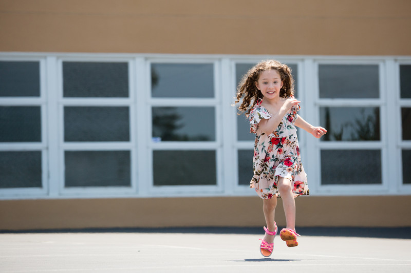 young girl running towards the camera