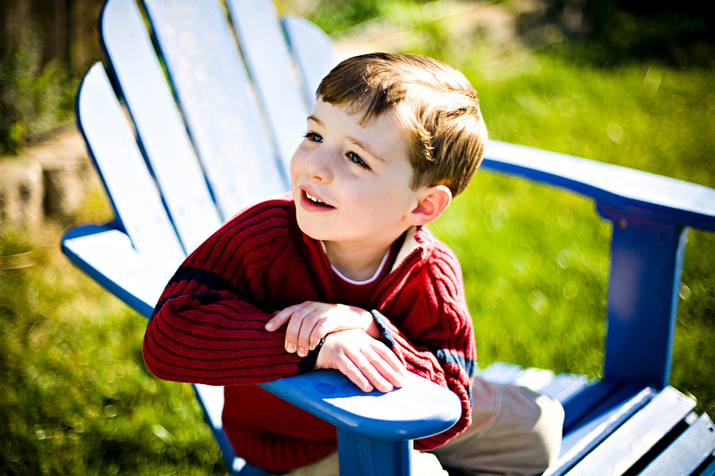 young-boy-blue-adirondack-chair