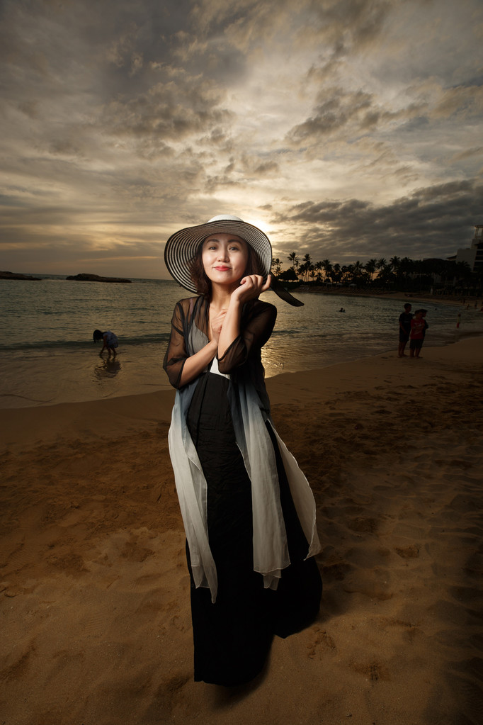 young-woman-beach-sunset