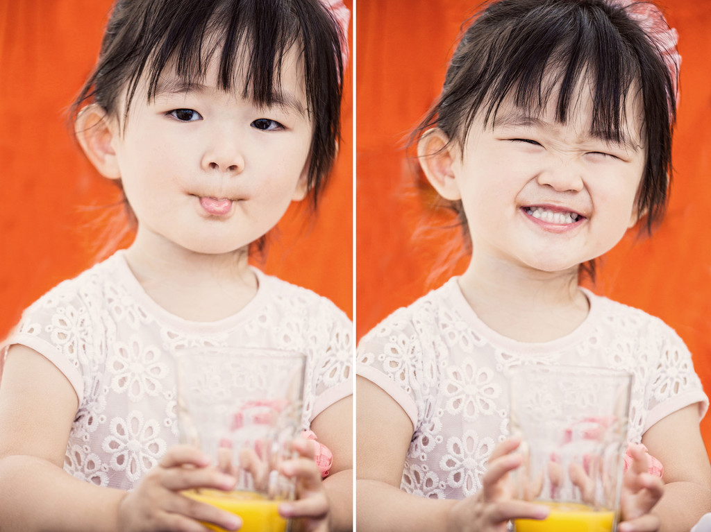 portrait-toddler-orange-juice-orange-background