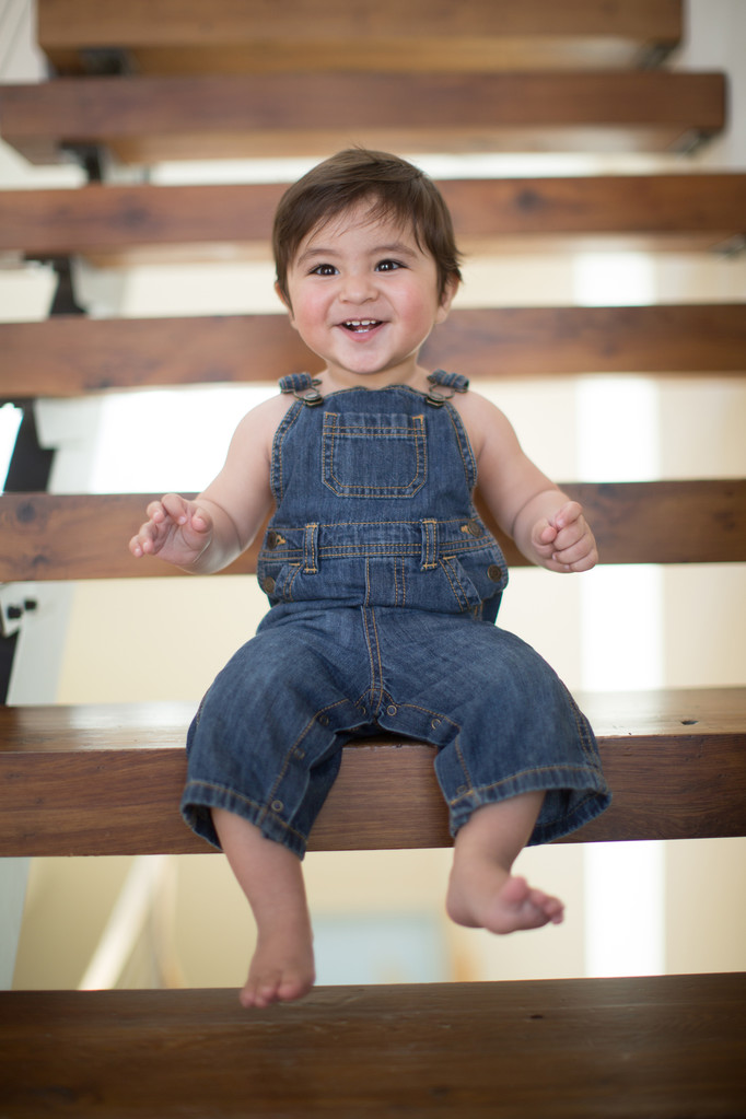 baby in denim overalls