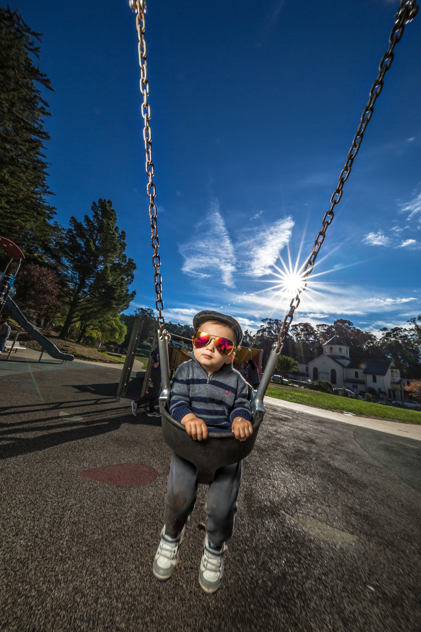 toddler in a swing sunglasses