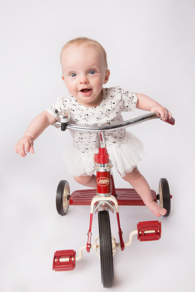 baby-girl-red-tricycle