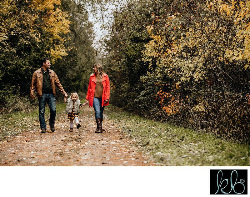 Family of three walking at Mill Lake Park