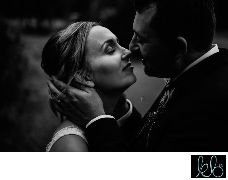 Groom and Bride Kissing Portrait