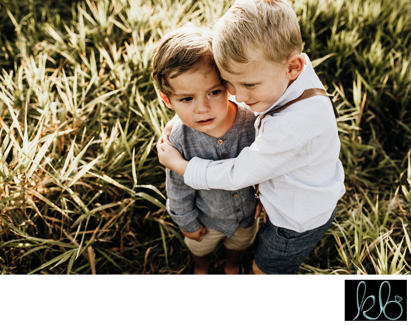Brother hugs brother during Family Photos