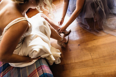 Bride Getting Shoes on Before Wedding
