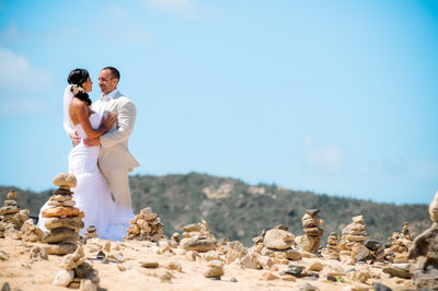 bride and groom stacked rocks in aruba