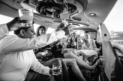 wedding party limo champagne cheers
