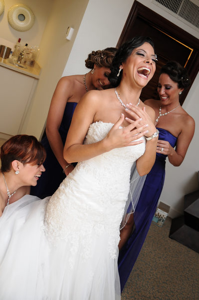 bride giggling in room getting ready