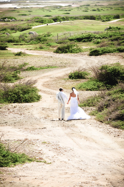 bride and groom walking curved path