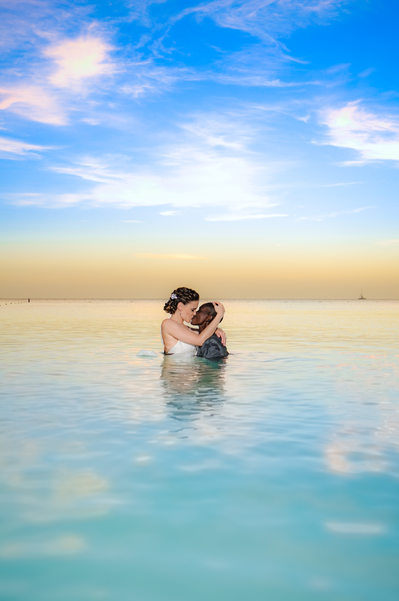 gay couple in water sunset