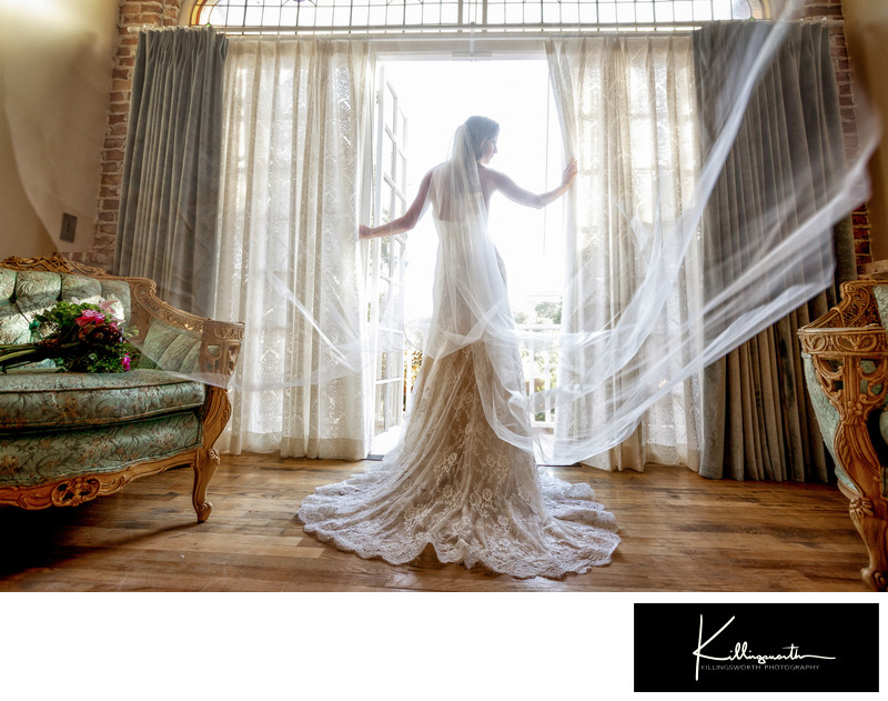 bride standing in front of 1880 union hotels bridal suite french doors