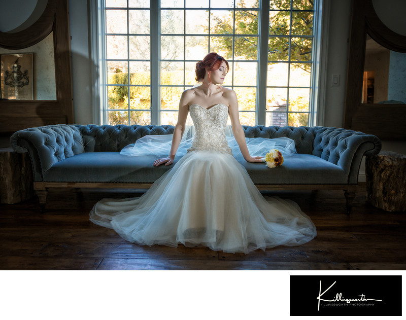 bride posing on villa aix vineyard wedding couch
