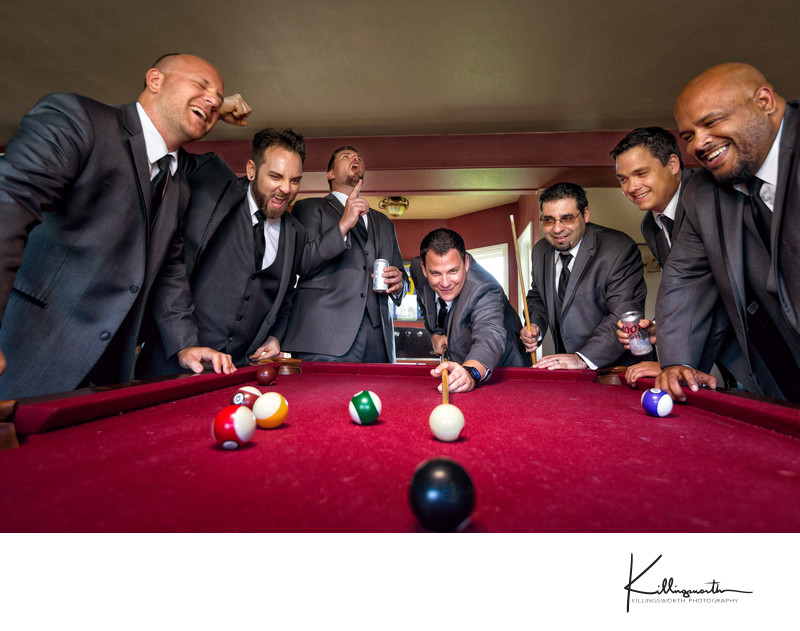 groomens playing a game of pool