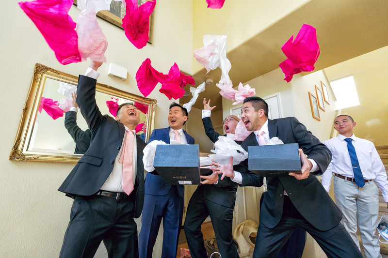 groom and groomsmen opening gifts