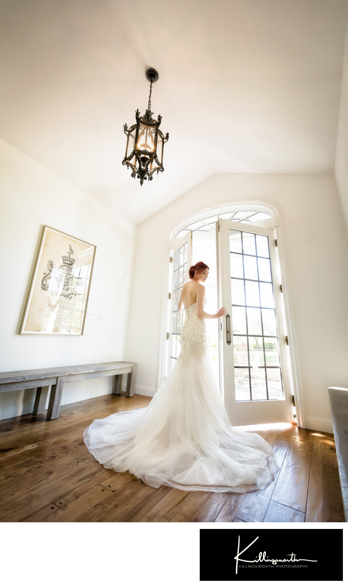 bride opening french doors to villa aix vineyard
