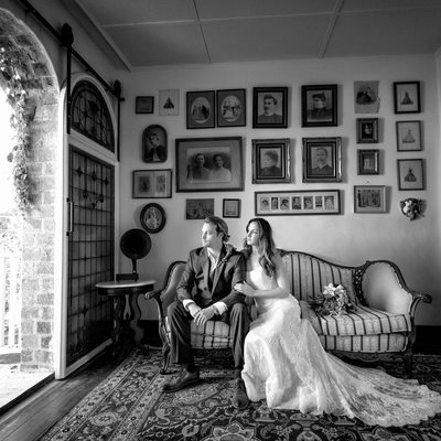 bride and groom sitting on couch at 1880 union hotel